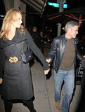 George Clooney and Stacy Keibler walked to their car arm in arm.