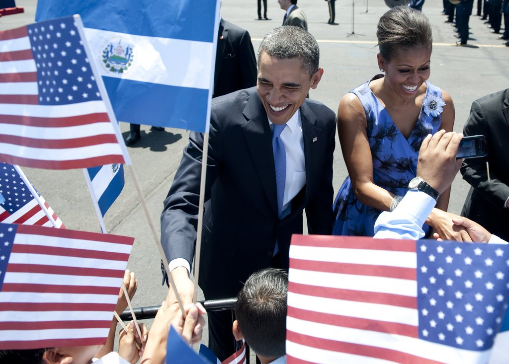 The Obamas seem eager to greet young school children upon arrival on Air Force One in San Salvador, El Salvador.
