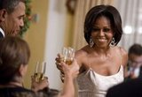 The Obamas raise their glasses during a state dinner in El Salvador.