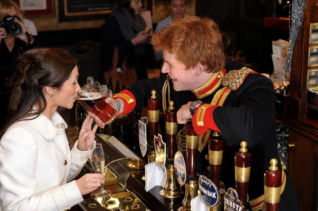 Harry look-alike serves Pippa look-alike a beer.