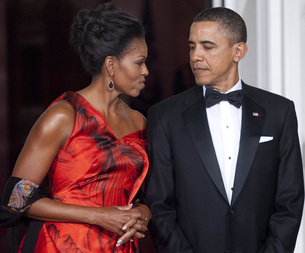 Barack notices how red-hot Michelle looks in Alexander McQueen at the start of a state dinner for the Chinese president.
