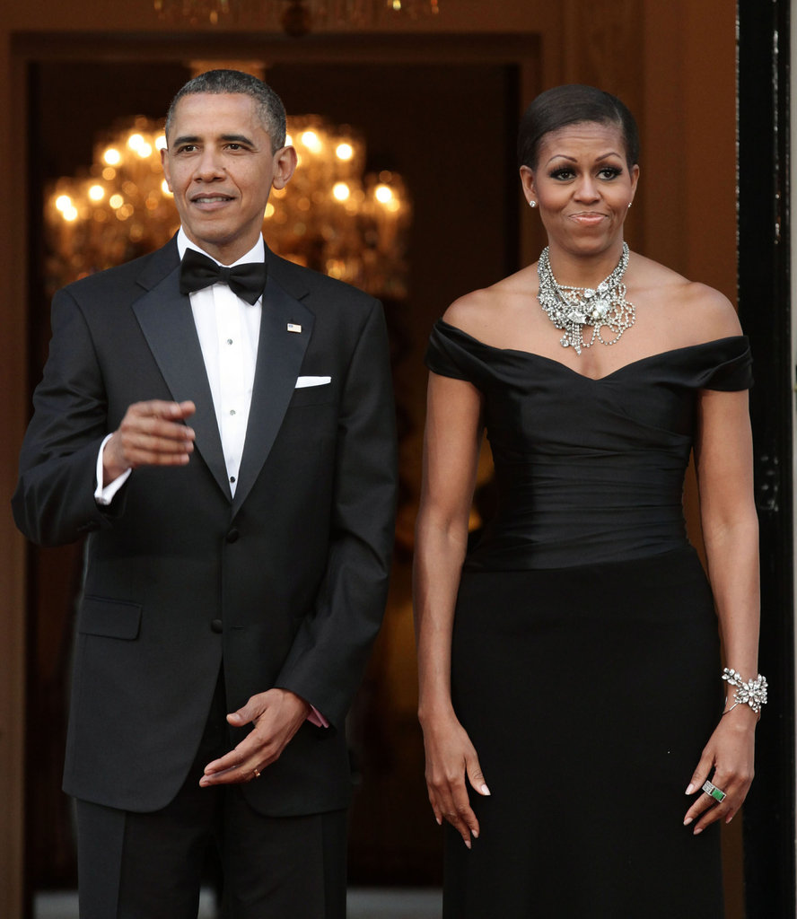 Barack and Michelle put on their finest as they wait for Queen Elizabeth at the residence of the US ambassador in London.