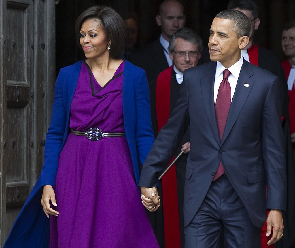 Barack holds on tight to Michelle's hand after a tour of Westminster Abbey.