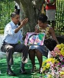 Bo helped Barack and Michelle read a book to a crowd of kids.