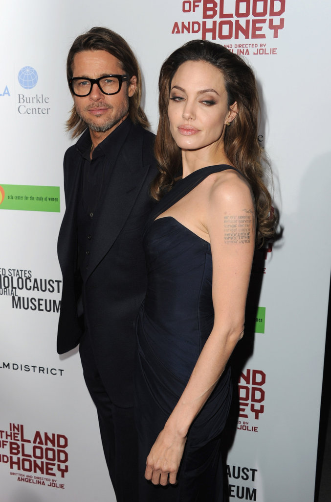 Angelina and Brad wore matching navy.