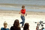 Jennifer Lopez running on the beach.