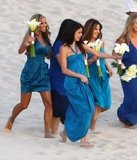 Selena Gomez ran around on the beach with her fellow bridesmaids.