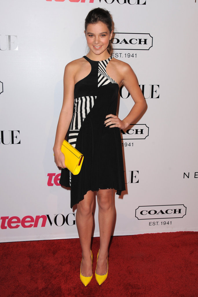 Looking geometric and gorgeous, she shined in a two-tone halter dress from Versace's Resort 2012 collection. Her Teen Vogue Young Hollywood party attire was made complete with bold yellow accessories.
