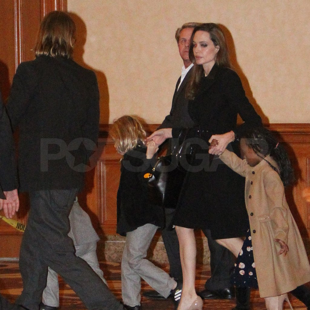 Shiloh and Zahara walked side by side with Angelina.