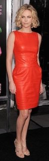 Charlize Theron in Orange Leather Christian Dior Dress