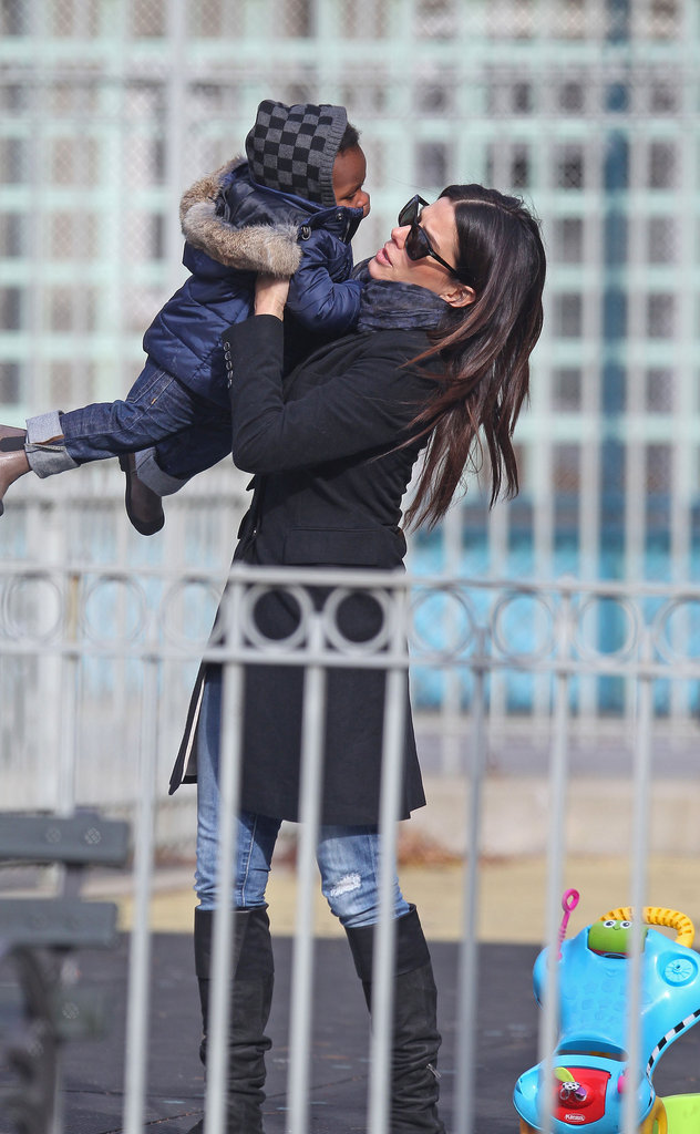 Sandra Bullock picks up Louis at a NYC playground.