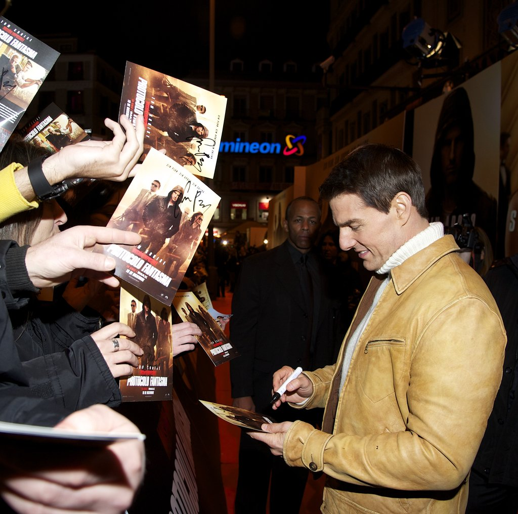 Tom Cruise signed autographs for fans.