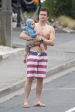 Orlando Bloom shirtless with Flynn in New Zealand.