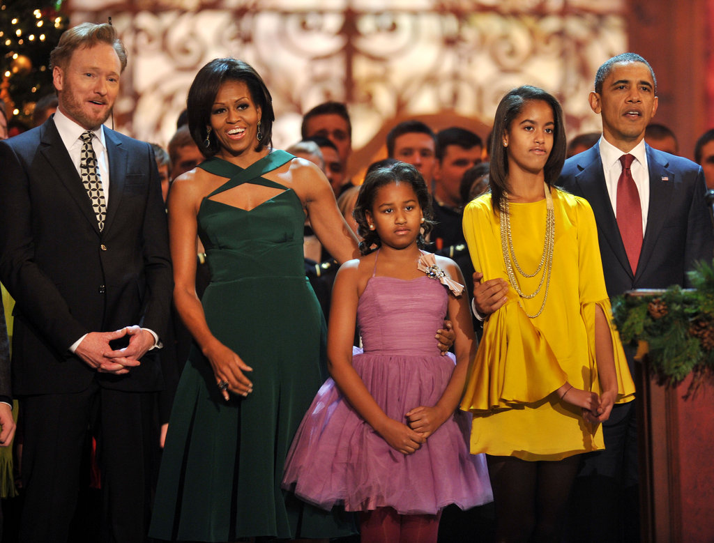 The Obama family stands with Conan O'Brien at Christmas in Washington.