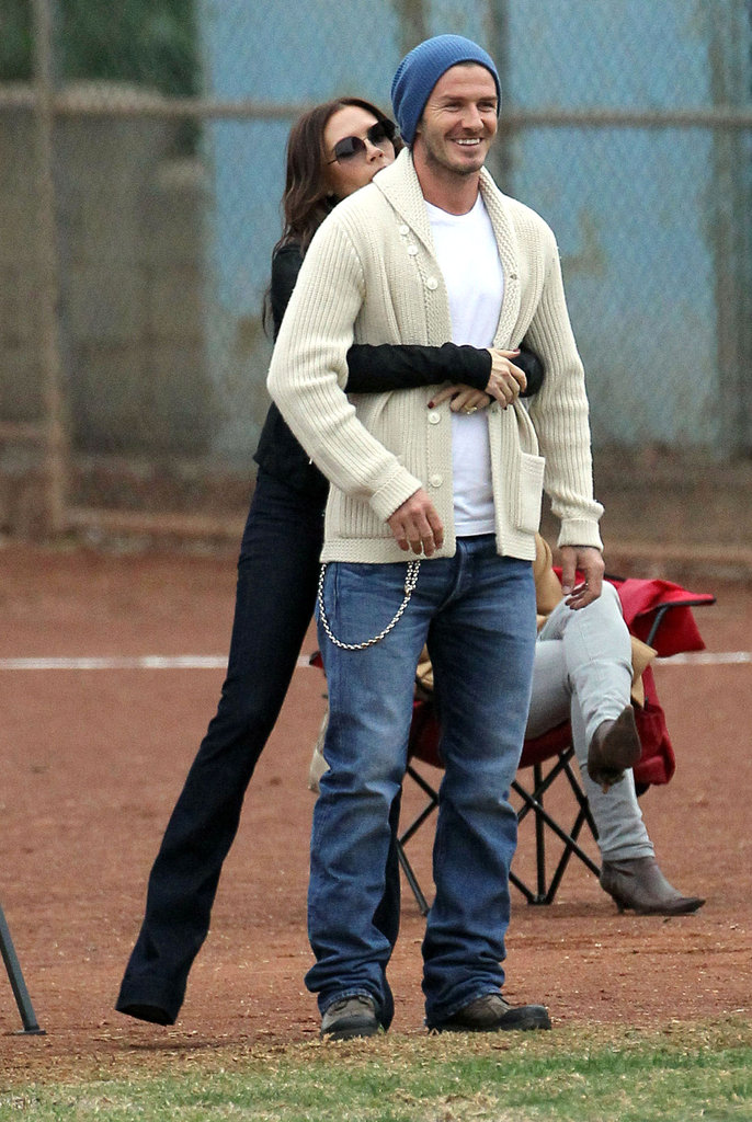 David and Victoria Beckham cuddled up on the sidelines while they watched Brooklyn, Romeo, and Cruz play soccer in LA in November 2011.