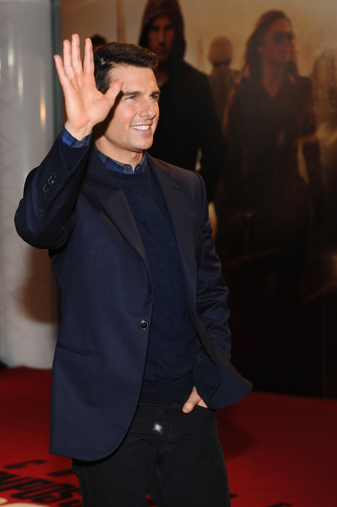 Tom waved to fans at the London premiere.