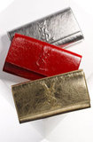 "Yves Saint Laurent ""Belle de Jour"" Metallic Envelope Clutch ($595)"