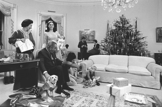 The Johnson family dives into unwrapping gifts while pup Yuki oversees the activity. Source: Lyndon Baines Johnson Library