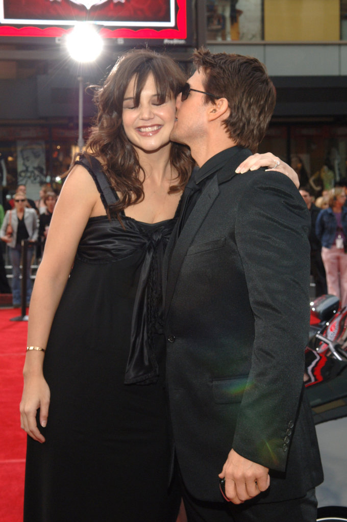 Tom Cruise planted a kiss on his smiling, pregnant wife, Katie Holmes, at the LA premiere of Mission: Impossible III in May 2006.