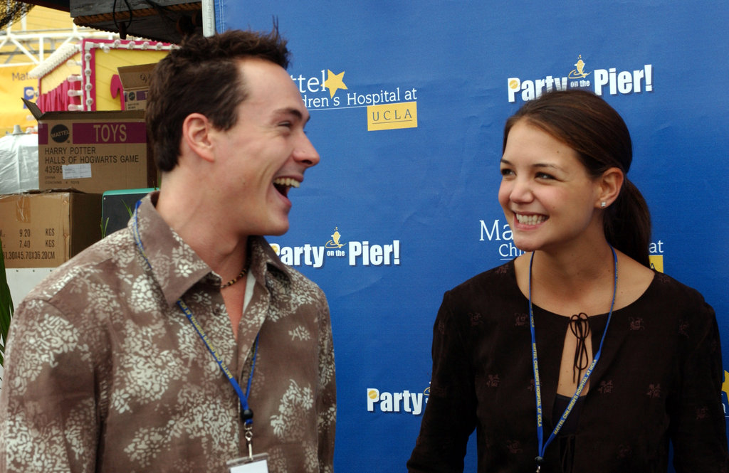 Katie had a laugh with then-boyfriend Chris Klein at an event in LA in September 2003.