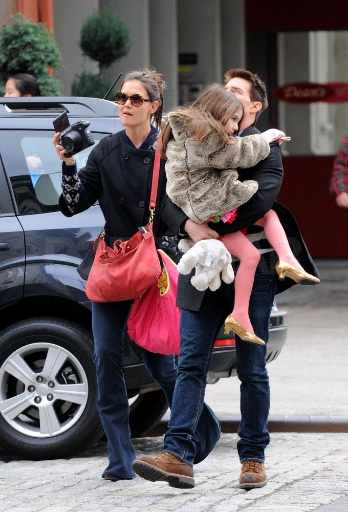Katie Holmes snapped photos during their walk around town.