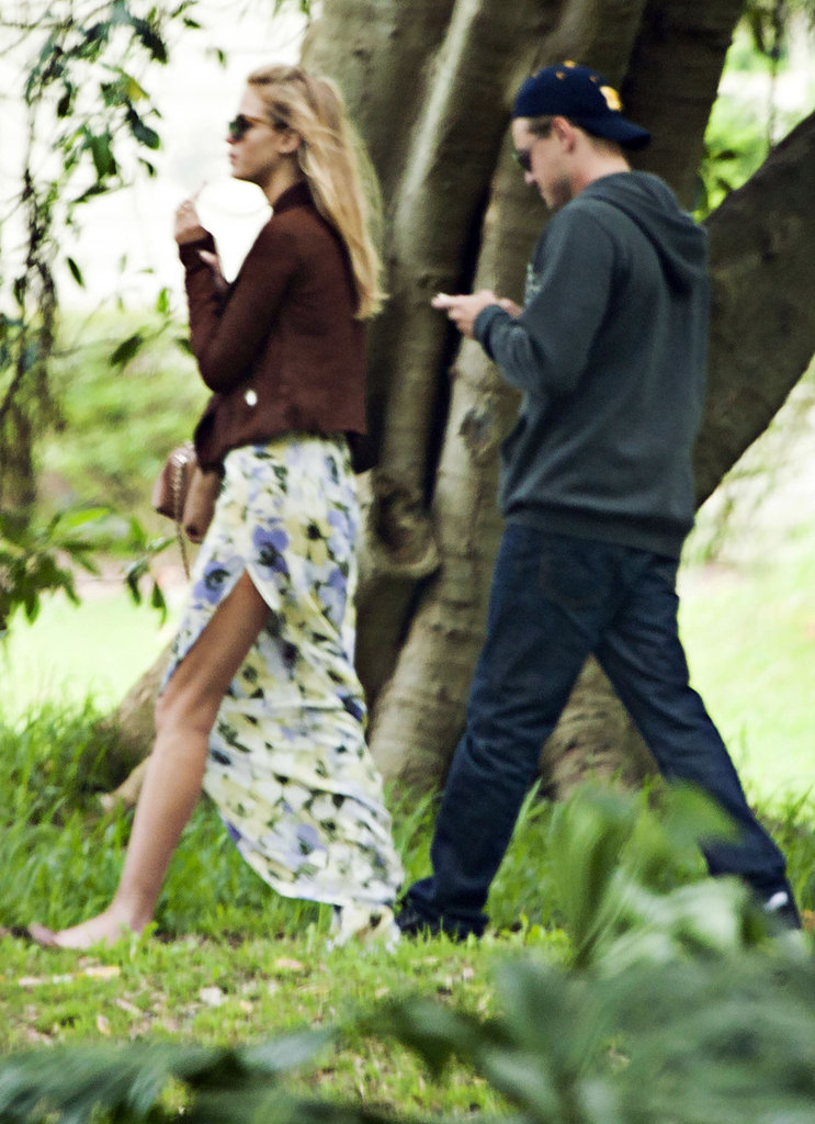 Leo checked his phone during their walk.