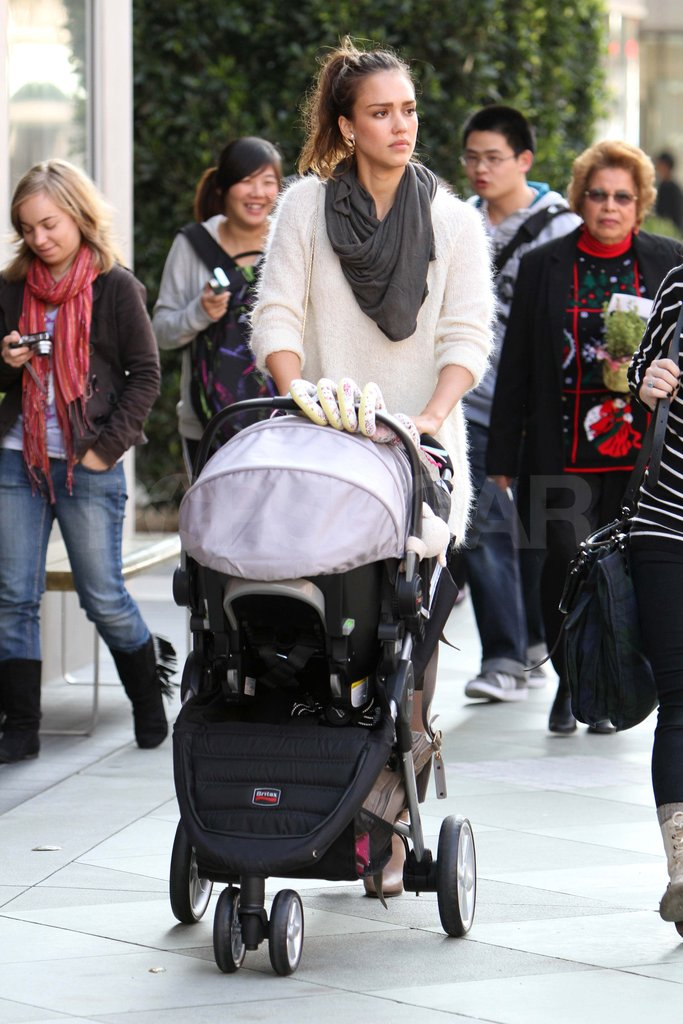 Jessica Alba pushing Haven's stroller.