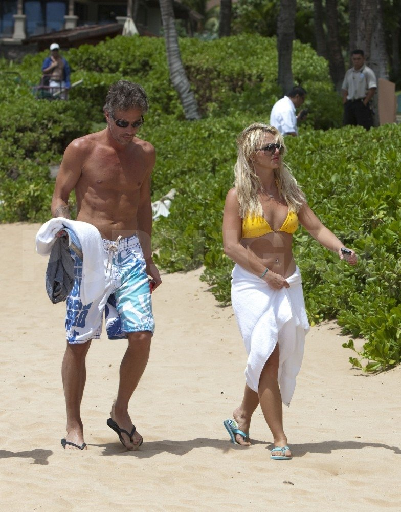 Britney modeled a yellow bikini in Hawaii with Jason in August 2010.