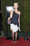 Charlize Theron accessorized her Stella McCartney dress with Manolo Blahnik cage heels.