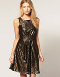 A flash of metallic that's bound to get you noticed at your holiday fetes.  Oasis Metallic Lace Skater Dress ($100)