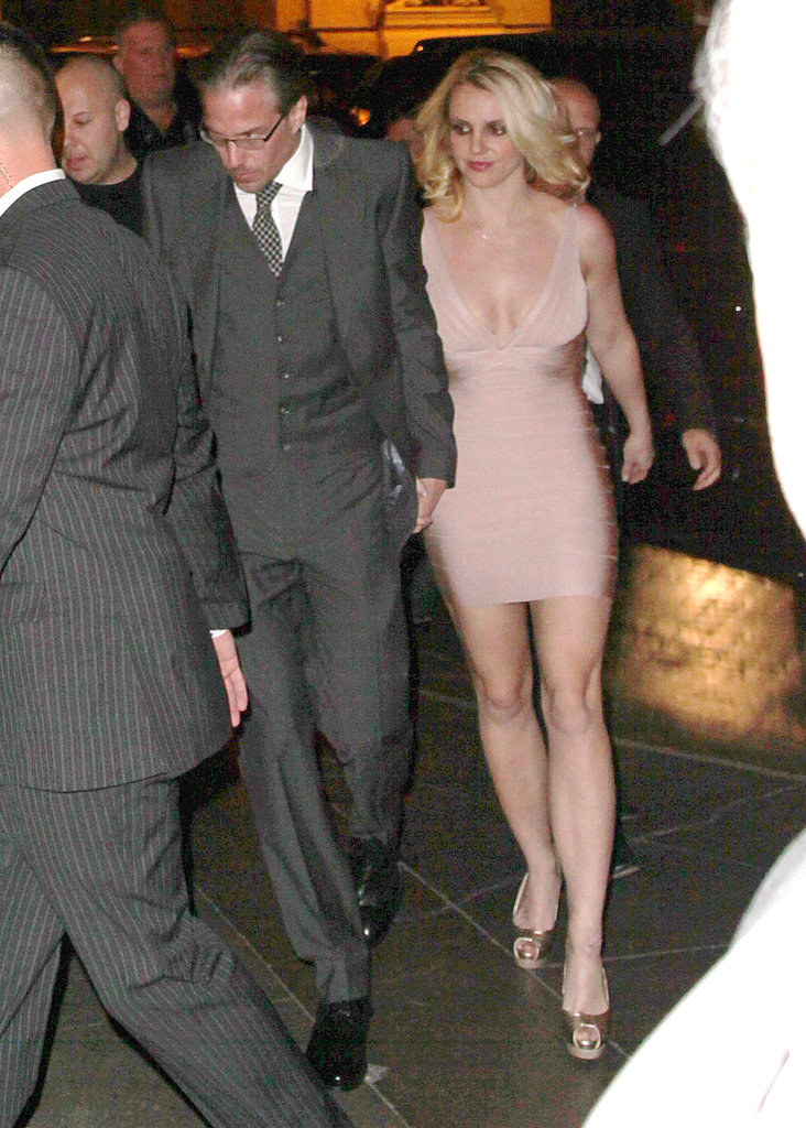 Britney wore a nude-colored wrap dress.