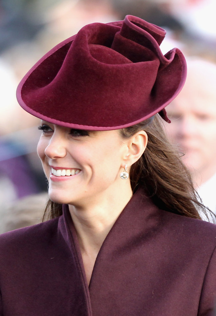 Kate wore a burgundy hat.