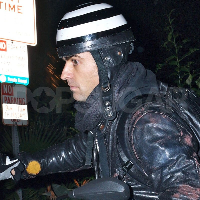 Justin Theroux left on his motorcycle after dinner in Santa Monica with Jennifer Aniston.