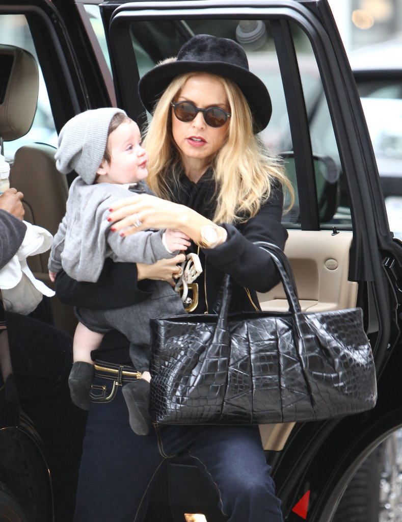 Rachel Zoe carrying her son, Skyler.