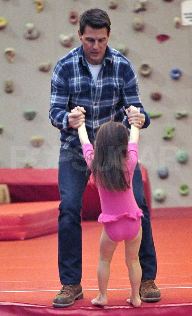 Tom Cruise and Suri Cruise did gymnastics.