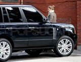 Gisele Bundchen getting into a Range Rover.