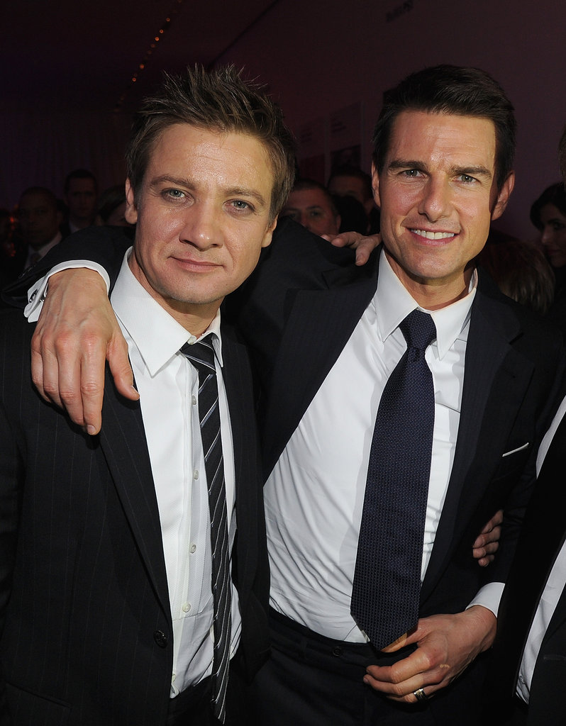 Jeremy Renner and Tom Cruise put their arms around each other in NYC.
