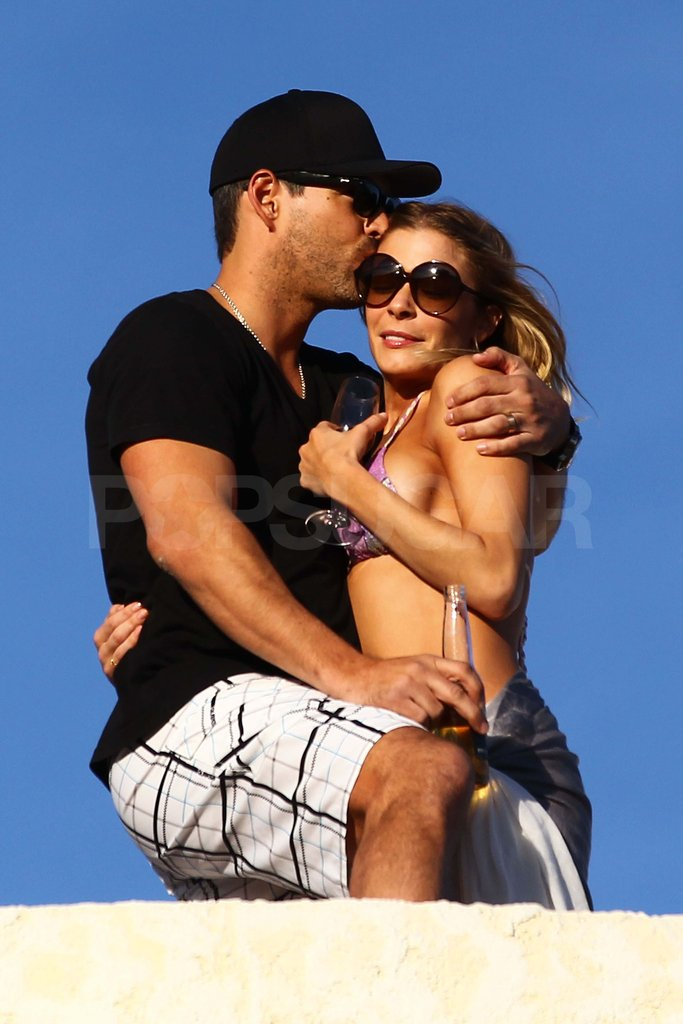 LeAnn Rimes and Eddie Cibrian kissing.