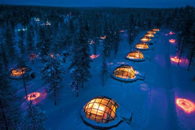 This stretch of illuminated igloos at the Hotel Kakslauttanen is located just above the Arctic Circle in Finland. Fortified with special thermal glass that keep temperatures at a cozy level, guests can enjoy the stunning Northern Lights in total comfort.   Source