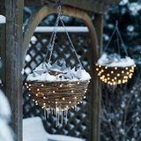 White lights and tin stars give these hanging planters a new use for the snowy holiday season.   Source