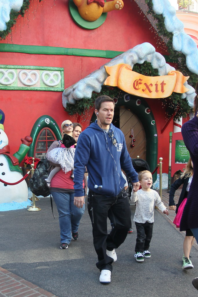 Mark Wahlberg held his son Brendan's hand.