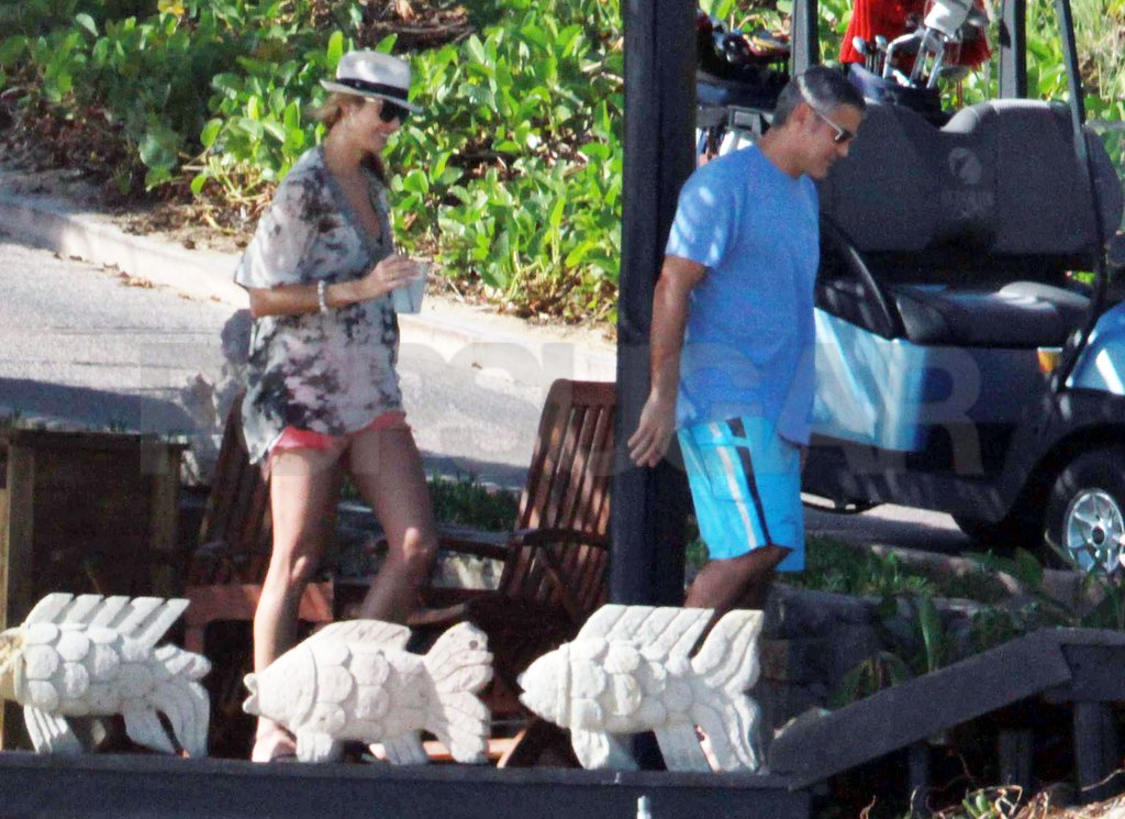 George Clooney and Stacy Keibler were both dressed for the warm weather.