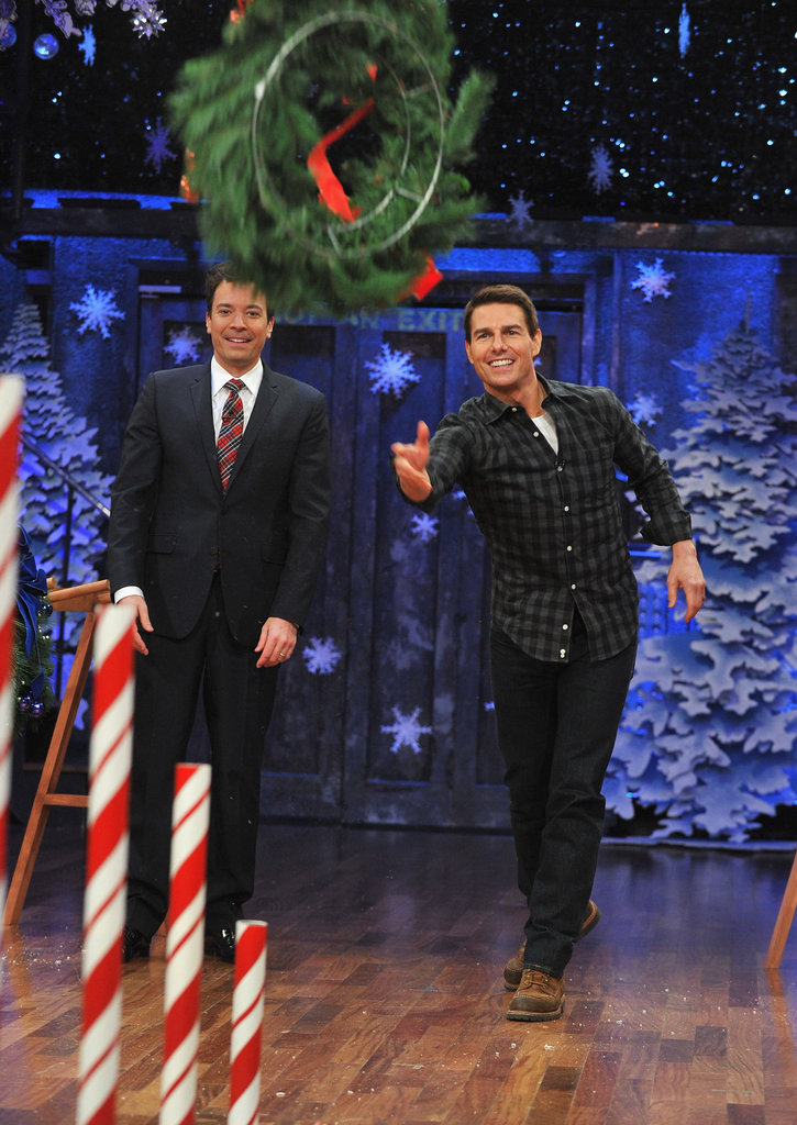 Tom Cruise gave tossing a wreath a whirl.