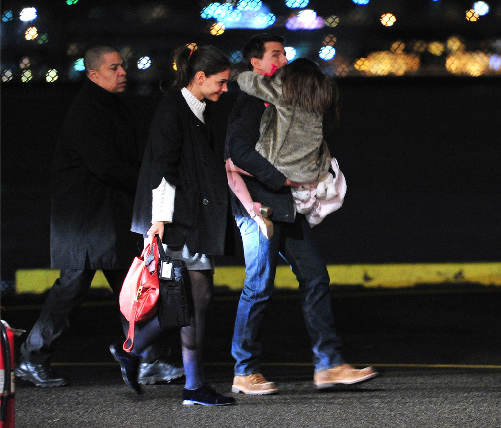 Katie Holmes walked with Tom Cruise and Suri Cruise to their helicopter in NYC.