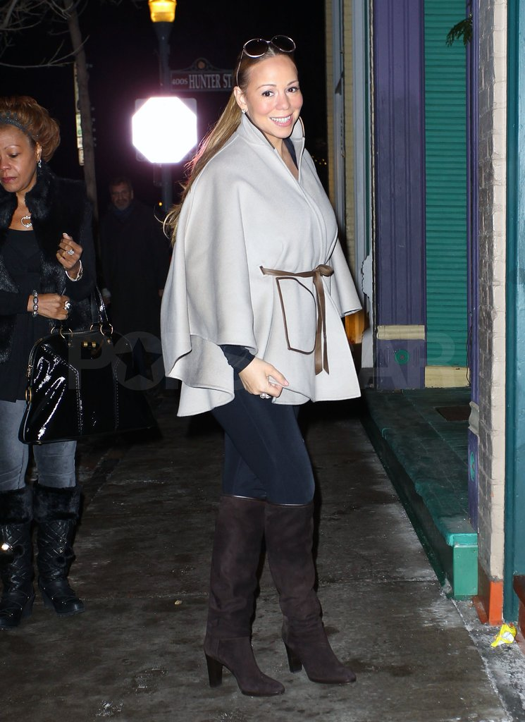 Mariah Carey wore a chic cape and tall boots.
