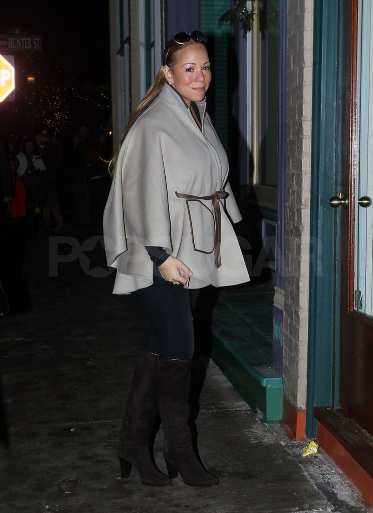 Mariah kept warm under a belted cape.