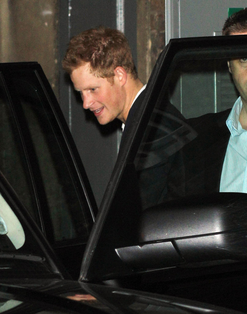 Prince Harry got into his car after rubbing shoulders with David Beckham.