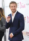 Cuteness overload! Ryan Gosling waves at the Drive premiere during the Los Angeles Film Festival.