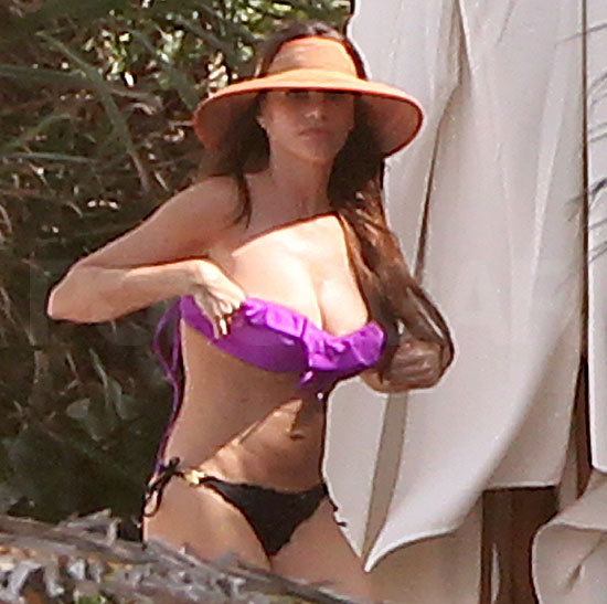 Sofia Vergara adjusted her two-piece bathing suit.