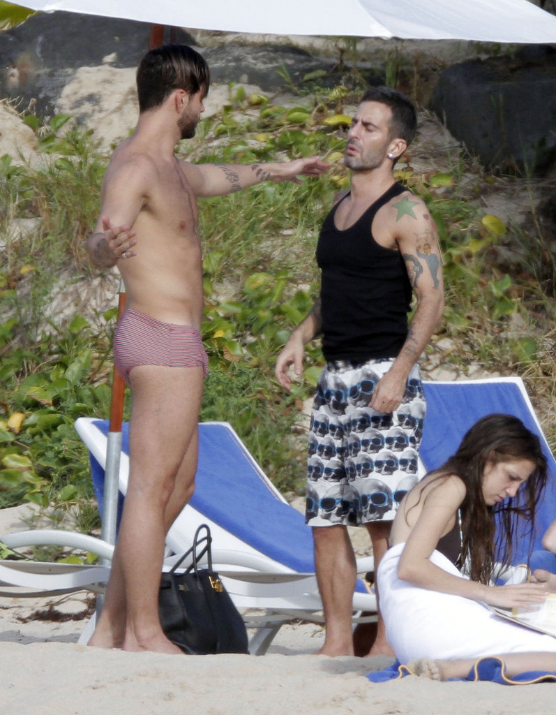 Shirtless Lorenzo Martone put his hand on Marc Jacobs's shoulder.